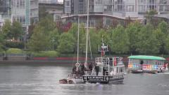 Police boat intercepting sailboat with watertaxi in background Stock Footage