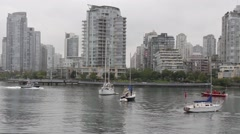 Police and fire boat meeting with sailboat Stock Footage