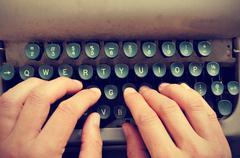 Typing on an old typewriter Stock Photos