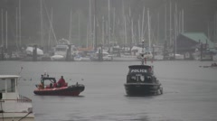Police and fireboat with dragon boat in background Stock Footage