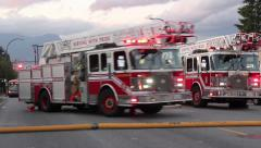 Fire truck driving on orange traffic cones Stock Footage