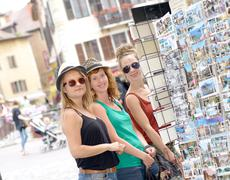 three young women make tourism in annecy - stock photo