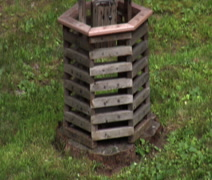 Wooden backyard wishing well Stock Footage