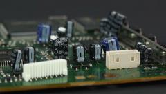 Zoom out of capacitors on DVD motherboard 2 Stock Footage