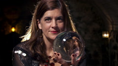 Clairvoyant holding a crystal ball HD Stock Footage