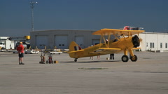 Single engine Boeing Stearman Kaydet Trainer  Rolling to tarmac for demo flight - stock footage