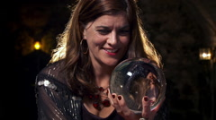 Laughing fortune teller with crystal ball HD Stock Footage