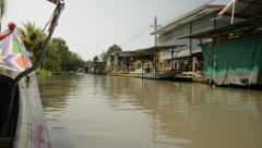 Thai long-tail boat turning a corner in a canal. Stock Footage