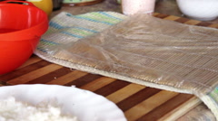The process of making sushi. Laid rice on the nori - #1 Stock Footage