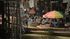 Boats with tourists floating on the Damnoen Saduak floating market(With sound) Stock Footage