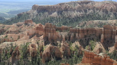 Horses travel a far distant trail through red rock formations Bryce Canyon Stock Footage