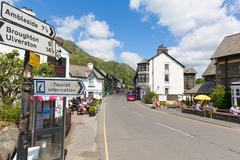 Coniston town Lake District England with hot sunny summer weather - stock photo