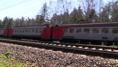 Suburban train of RZD (russian railway) rides to the station Stock Footage