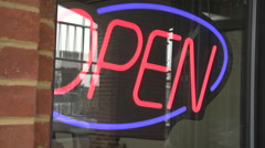 Small business window with open sign on Stock Footage