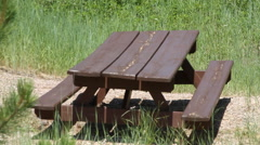 Old picnic table in the forest - stock footage