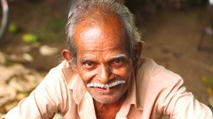 Portrait of local man with moustache selling at Hikkaduwa Sunday market. Stock Footage