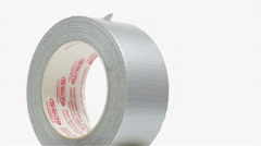 Duct tape rotating on white background - stock footage