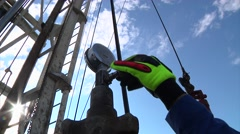Drilling Rig Worker Turns Valve Stock Footage