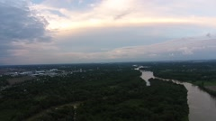 Aerial shot camera panning above river during cloudy sunset Stock Footage