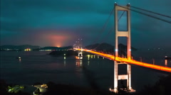 Time lapse of Japanese boats underneath the giant suspension bridges of Imabari. Stock Footage