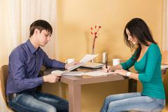 Couple signs documents - stock photo
