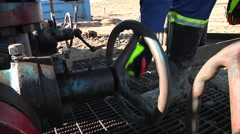 Oil Field Worker Turns Valve 2 - stock footage