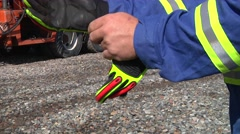 Oil worker puts on gloves 2 Stock Footage