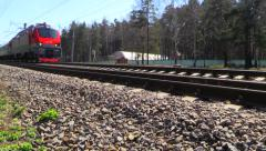 Passenger train RZD (Russian railways) rides to the station. Stock Footage