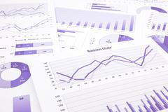 Purple business charts, graphs, data and report summarizing background Stock Photos