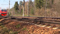 Red-gray suburban train of RZD (russian railway). With blurred logo. Stock Footage