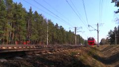 Russian railway. Suburban train of RZD rides to the station Stock Footage