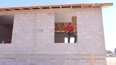 Dry waller at a construction site Stock Footage