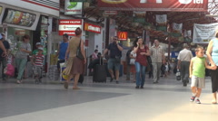 Inside railway station, commuters with luggage moving, public crowded place Stock Footage