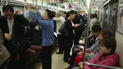 2of10 Japanese people, commuters traveling, subway train, Osaka, Japan, Asia Stock Footage