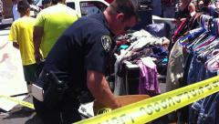 san diego police putting up yellow tape flea market stabbing - stock footage