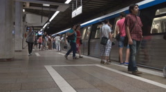 Subway train in station, commuters using public transport, underground traveling Stock Footage