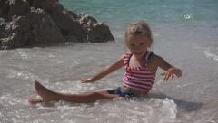 Child Playing in Waves, Happy Little Girl on Tropical Exotic Beach, Coastline Stock Footage