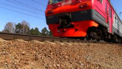 Russian railway. Red-gray suburban train of RZD. With blurred logo. Stock Footage