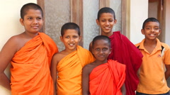 The view of Buddhist monk boys in a Buddhist temple in Galle. Stock Footage