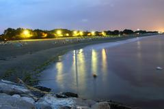 night view of the beach with lit - stock photo