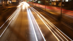 Vehicles Traveling Fast on Expressway at Night - stock footage