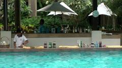 Thailand Pattaya 014 ravindra beach resort, pool bar in water with waiter Stock Footage