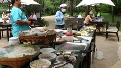 Thailand Pattaya 009 ravindra beach resort, asian waiters prepare buffet Stock Footage