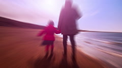 Retro dream of mother and child walking on a beach Stock Footage