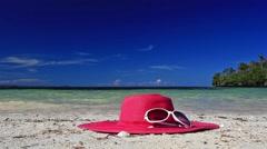 Sun hat and sunglasses on tropical beach Stock Footage