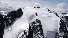 Stock Video Footage Flying over ice-capped mountains Stock Footage