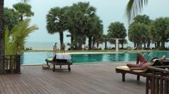 Thailand Pattaya 005 ravindra beach resort, ocean behind swimming pool Stock Footage