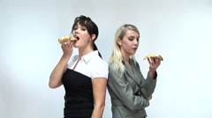 HD1080i Two young woman eats fresh delicious pizza Stock Footage