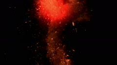 Red ash ascending like in a real explosion, on black background Stock Footage