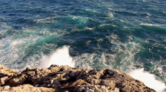 Strong waves hitting against rocks Stock Footage